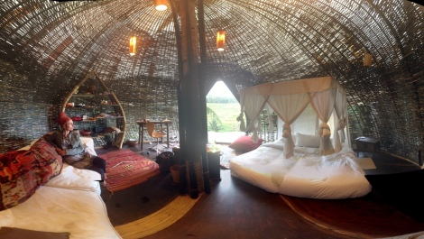 Fiona Gavino sitting inside a woven bamboo room at the Green Village