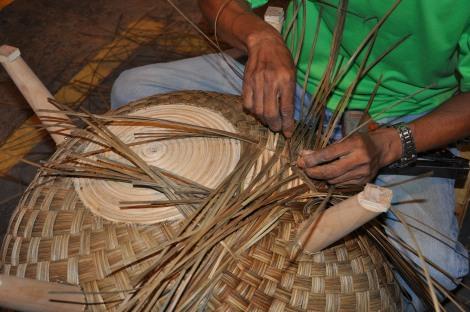 A Kenneth Cobenpue designed chair being made by a rattan master craftsmen